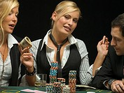 Happy woman with cash at poker game