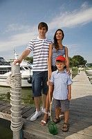 Portrait of young family on pier