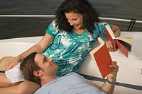 Couple reading on boat