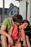 Affectionate couple sitting on porch
