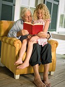 Grandfather reading to granddaughter (thumbnail)