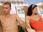 Upset couple near poolside (thumbnail)