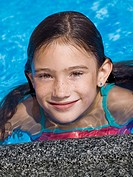 Smiling girl in pool (thumbnail)