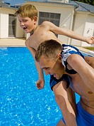 Man and boy playing at pool