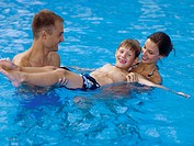 Happy family in pool (thumbnail)