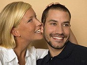 Woman biting man's ear
