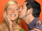 Close-up of man kissing woman