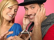 Couple listening to MP3-player