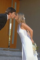 Bride and groom kissing (thumbnail)