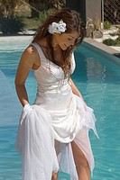 Happy bride near pool