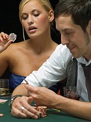 Woman holding ice cube at poker game
