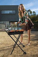 Woman at barbecue