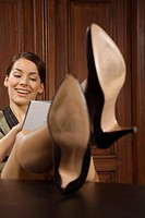 Happy businesswoman with her feet up