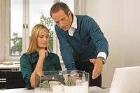 Two architects discussing on an architectural model