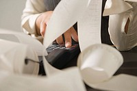Close-up of a businesswoman´s hand calculating on an adding machine
