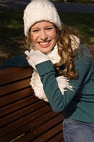 Portrait of young happy woman in winter clothes