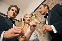 Portrait of three people holding champagne flutes