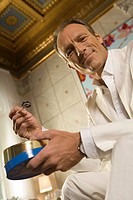 Low angle view of a mature man eating caviar (thumbnail)