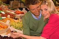 Portrait of a mid adult couple sitting in a supermarket and smiling (thumbnail)