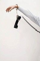 Businessman handcuffed to telephone receiver