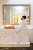 Woman sitting next to bubble bath