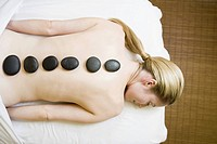 Woman receiving spa stone treatment (thumbnail)