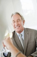 Senior businessman toasting