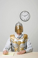Businessman wearing gladiator armor