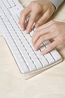 Close up businesswoman typing