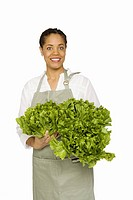 Woman holding fresh produce