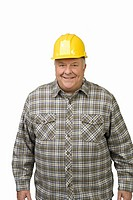 Senior man wearing hard hat
