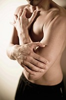 Bare-chested man with hand on elbow (thumbnail)