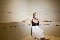 Woman in bathrobe sitting in sauna