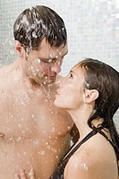 Couple hugging in shower
