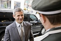 Businessman smiling at bellhop