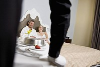Couple getting hotel room service