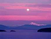 Moonrise over Mt. Baker looking out accross Fidalgo Bay from Anacortes, Washington, USA