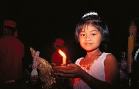 Girl holding candle, Bangkok. Thailand