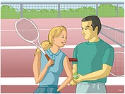 A couple playing tennis at a court