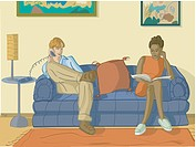 A man and woman sitting on the couch in their house