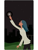 Businesswoman reaching for a star