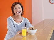 Portrait of a woman having her breakfast
