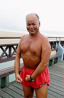 Chinese man making physical exercise. East coast of Taiwan. Republic of China