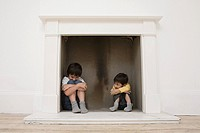 Boys hiding in a fireplace
