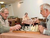 Senior men playing chess