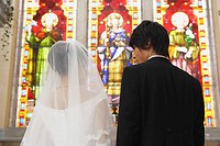 Bride Standing with Groom in Church