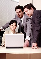 Three business people at laptop in office (thumbnail)