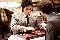 Two businessmen playing backgammon (thumbnail)