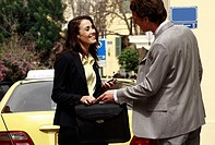 Businessman and woman meeting on street