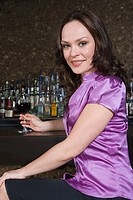 Woman sitting in a bar